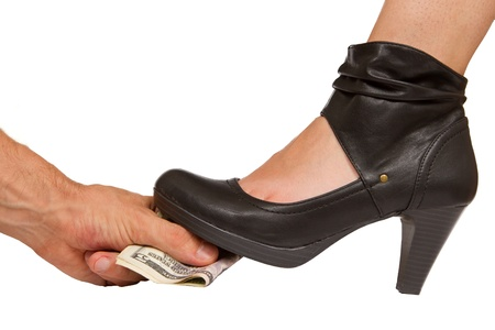 Person giving money for something less than legal... A sexy boot steps on top of it Stock Photo - 15388948