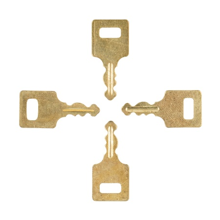 Four golden keys placed in a square, isolated on white background photo