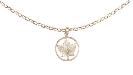 silver maple: Old filthy silver hanger on a silver chain (maple leaf), isolated on white