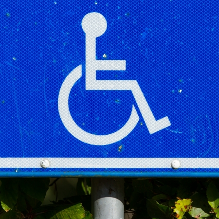 Close-up of a dirty parking sign for disable people Stock Photo - 15350329