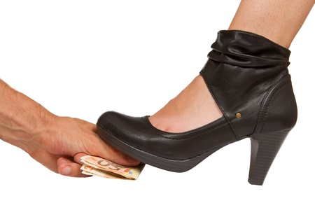Person giving money for something less than legal... A sexy boot steps on top of it Stock Photo - 15397683