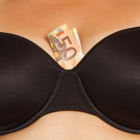 Concept - woman with cash in a bra (50 euro) Stock Photo - 15405012