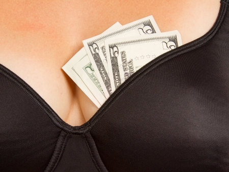 Concept - woman with cash in a bra (10 dollar) Stock Photo - 15600430