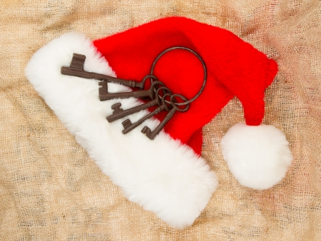 Santa's old rusty keys isolated on canvas photo