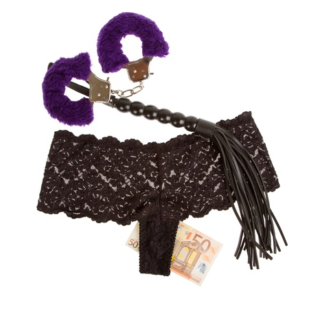Fluffy purple handcuffs, a whip, money and panties on a white background, prostitution Stock Photo - 15790241