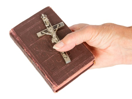 jezus: Old hand (woman) holding a very old bible, isolated on white Stock Photo
