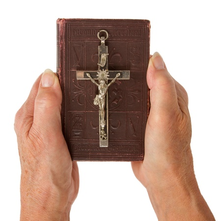 jezus: Old hands (woman) holding a very old bible, isolated on white Stock Photo