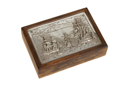 Silver engraving on a old wooden box, isolated on white photo