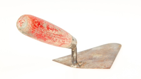Used trowel, isolated on a white background photo
