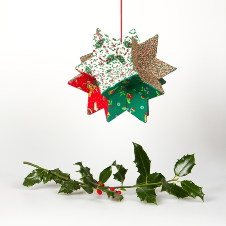 Butchers broom and christmas decoration, isolated on white photo