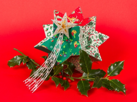 Christmas decoration isolated on a red background photo