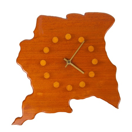 Wooden clock in the shape of the country Surinam, isolated on white photo