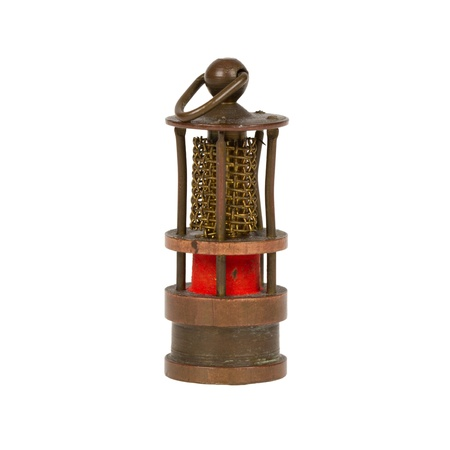 pitman: Very old miniature of a miners lamp, isolated on white