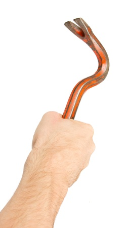 Hand holding old red crowbar on a white background photo