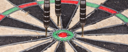 Close-up of a very old dartboard, isolated photo