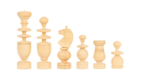 Set of old handcarved chess pieces isolated on a white background photo