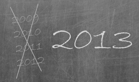 2009, 2010 and 2012 crossed and new year 2013 written on chalkboard, isolated Stock Photo - 16160611
