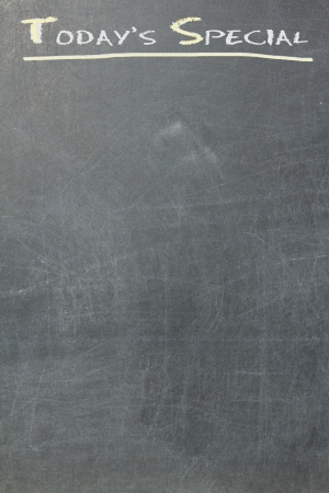 Todays special written on a blackboard, yellow and white photo