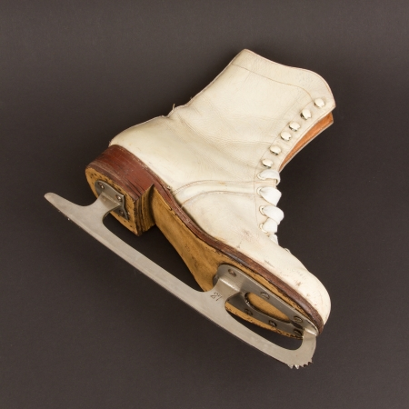 Very old figure skate, isolated on black background photo