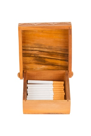 Cigarettes in handcarved wooden box, isolated on white Stock Photo - 16493697