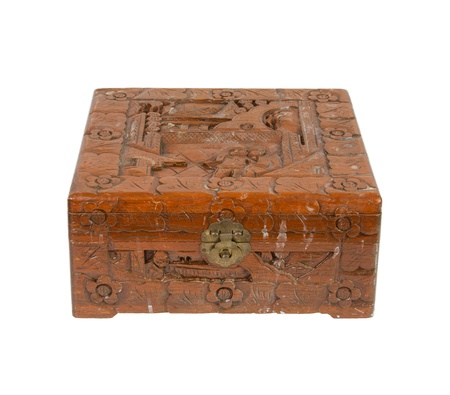 Old wooden chest made in Suriname, isolated on white photo