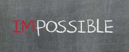 Possible and impossible written on a blackboard Stock Photo - 16631510