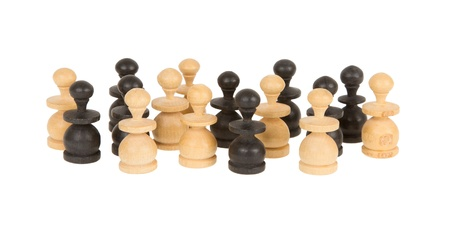 Old handcarved chess pieces isolated on white background photo