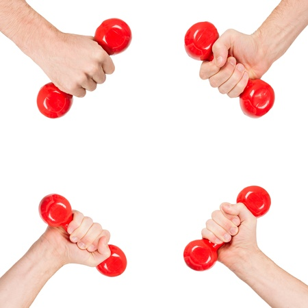 Red dumbbells in the hands of a man, isolated on white photo