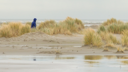 Lonely woman walking on a beach in Holland Stock Photo - 17069065