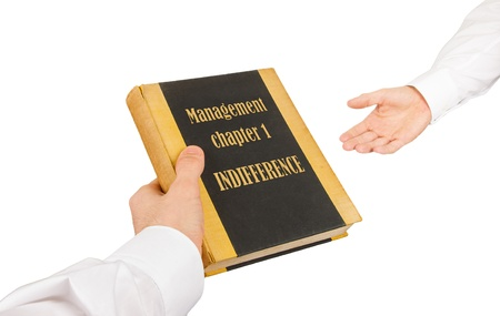 Businessman giving an used book to another businessman, management chapter 1 - indifference Stock Photo - 17242498