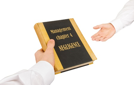 Businessman giving an used book to another businessman, management chapter 1 - indifference Stock Photo - 17242496