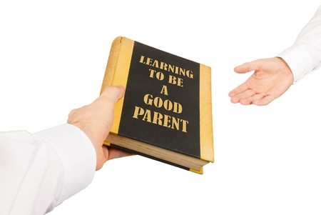 Businessman giving an used book to another businessman, learning to be a good parent Stock Photo - 17242492