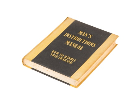 Old book with a mans instructional manual concept title, white background photo