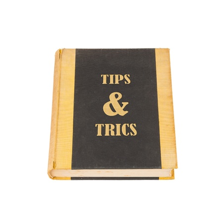 cheat: Old book with a tips and trics concept title, white background Stock Photo