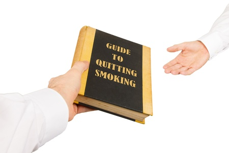 Businessman giving an used book to another businessman, guide to quiting smoking Stock Photo - 17272633