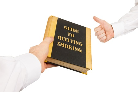 quiting smoking: Businessman giving an used book to another businessman, guide to quiting smoking