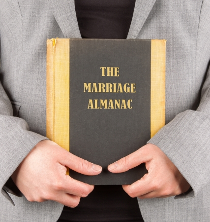 Woman holding a marriage almanac, saving her marriage Stock Photo - 17314369