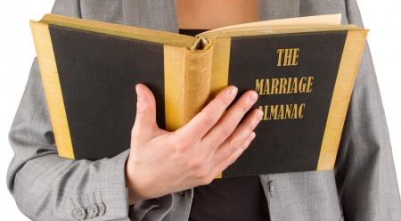 almanac: Woman reading a marriage almanac, saving her marriage
