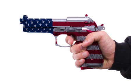 glock: Pistol with USA flag pattern in hand, isolated on white background Stock Photo