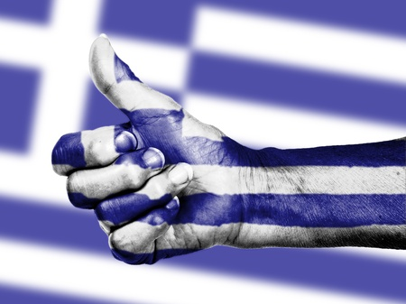 Greek flag on thumbs up hand isolated on a flag background photo