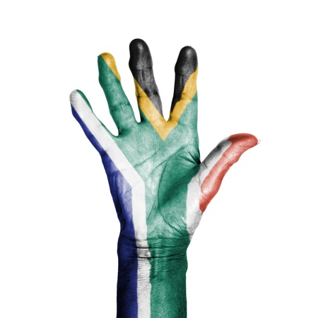 Hand of an old woman, wrapped with a pattern of the flag of South Africa, isolated on white photo