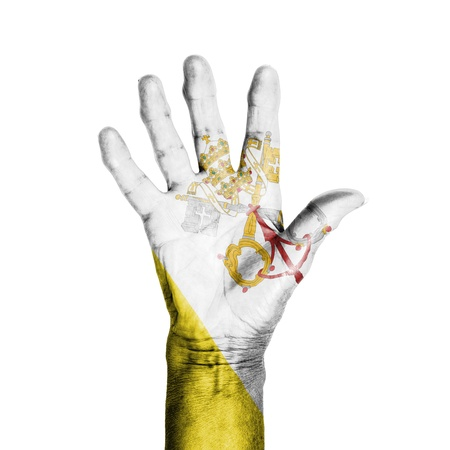 Hand of an old woman, wrapped with a pattern of the flag of the Vatican, isolated on white Reklamní fotografie