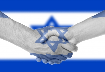Man and woman shaking hands, arms wrapped in the flag of Israel Stock Photo - 17331396