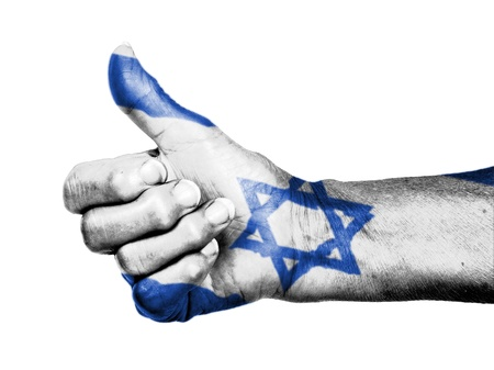 Old woman with arthritis giving the thumbs up sign, wrapped in flag pattern, Israel Stock Photo - 17364746