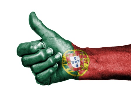 picking up: Old woman with arthritis giving the thumbs up sign, wrapped in flag pattern, Portugal