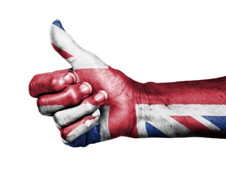 Old woman with arthritis giving the thumbs up sign, wrapped in flag pattern, United Kingdom Stock Photo - 17364739