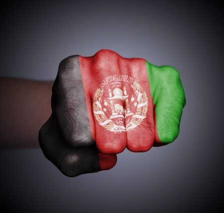 Front view of punching fist on gray background, flag of Afghanistan Stock Photo - 17387839