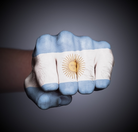 Front view of punching fist on gray background, flag of Argentina Stock Photo - 17387825