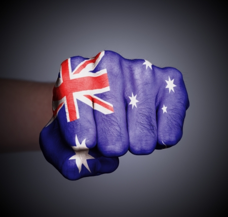 Front view of punching fist on gray background, flag of Australia Stock Photo - 17387808