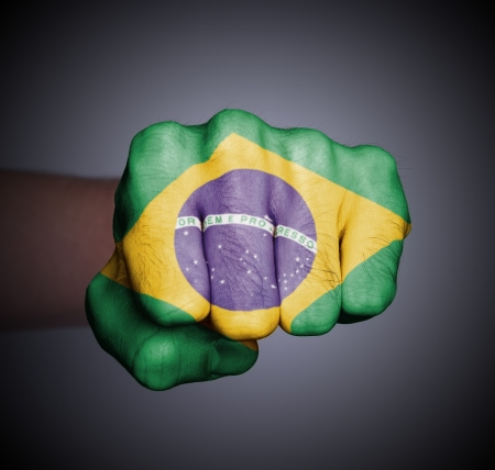 Front view of punching fist on gray background, flag of Brazil Stock Photo - 17387812
